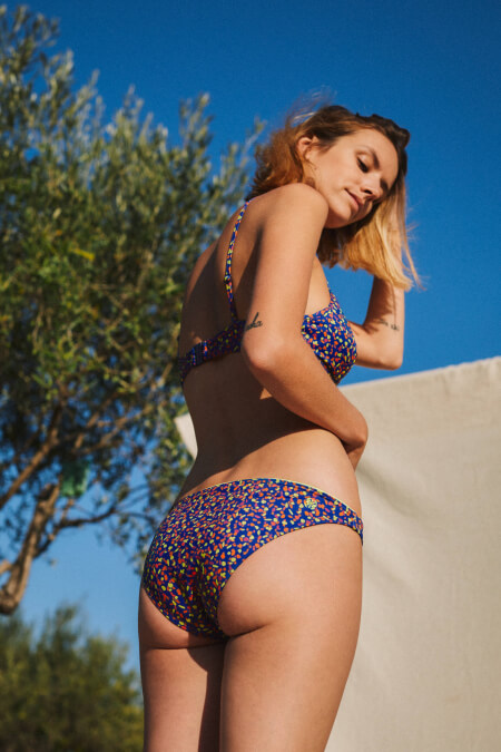 bottom of a two-piece swimsuit graffiti focus