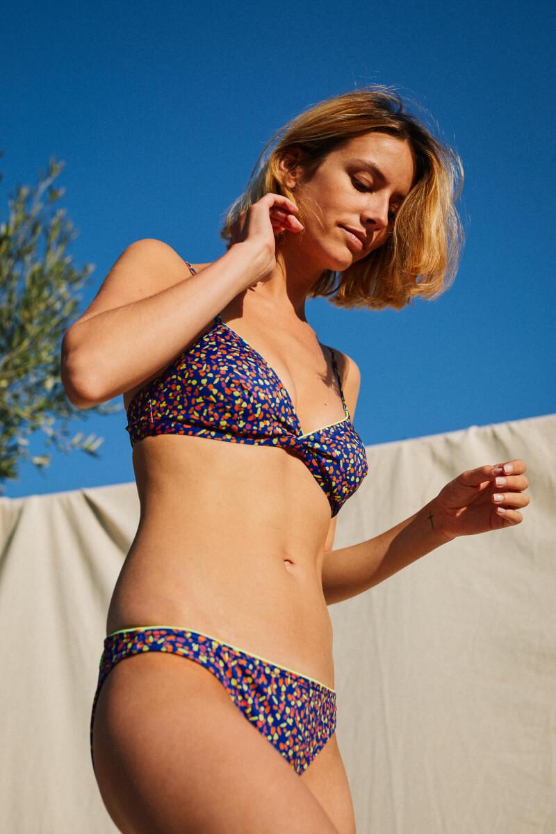 woman wearing a two-piece swimsuit graffiti