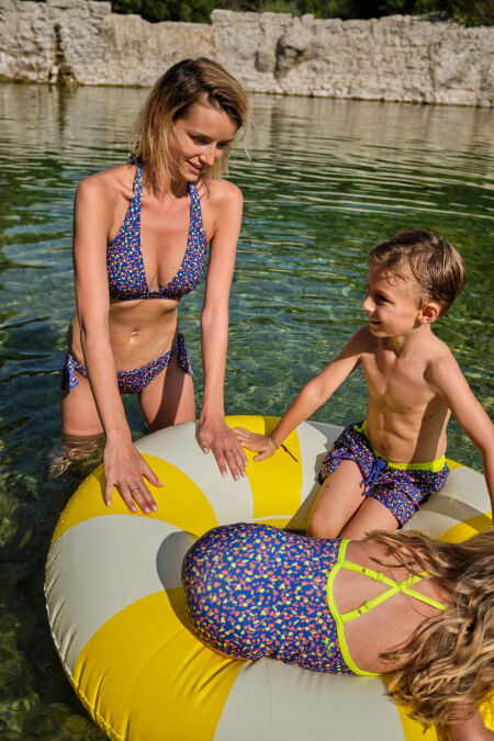 mother and son wearing a matching swimsuit graffiti