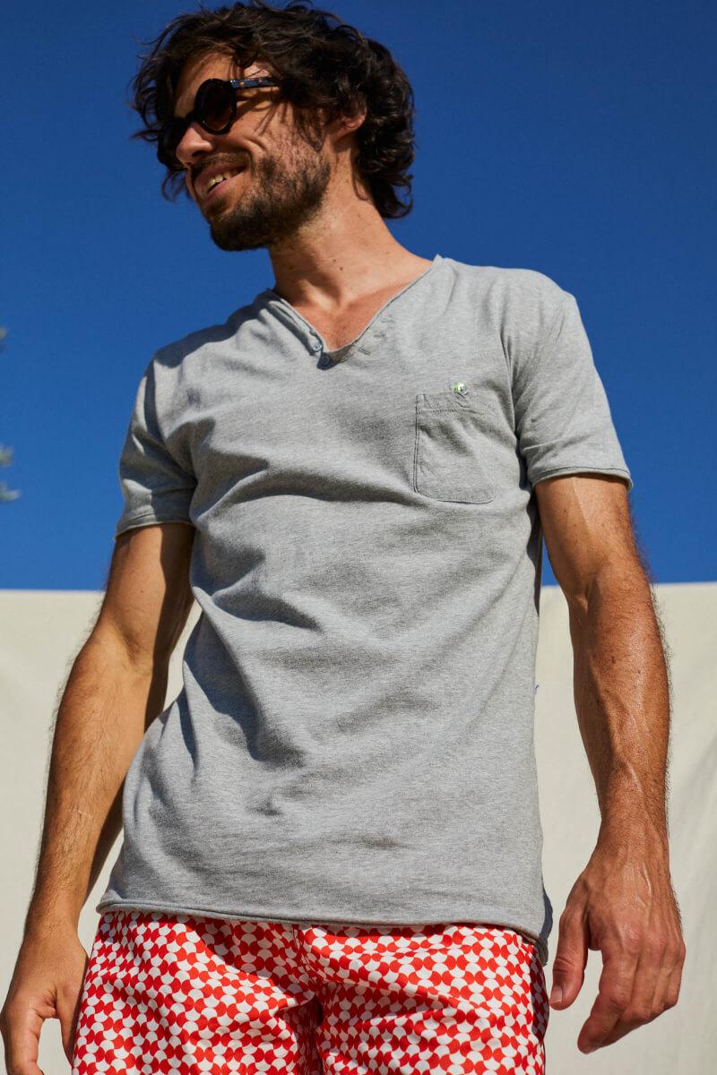man wearing a grey t-shirt with tunisian collar