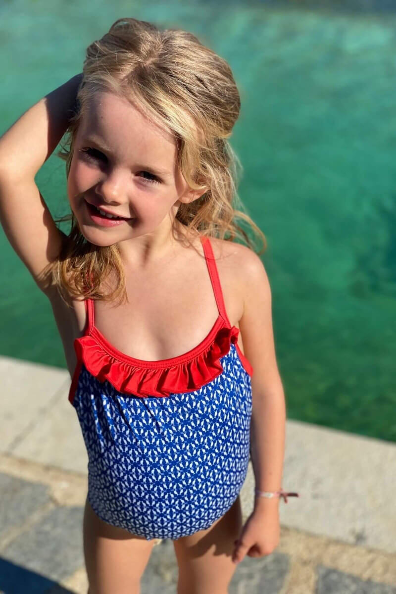 Girl wearing a one-piece swimsuit navy kangaroos