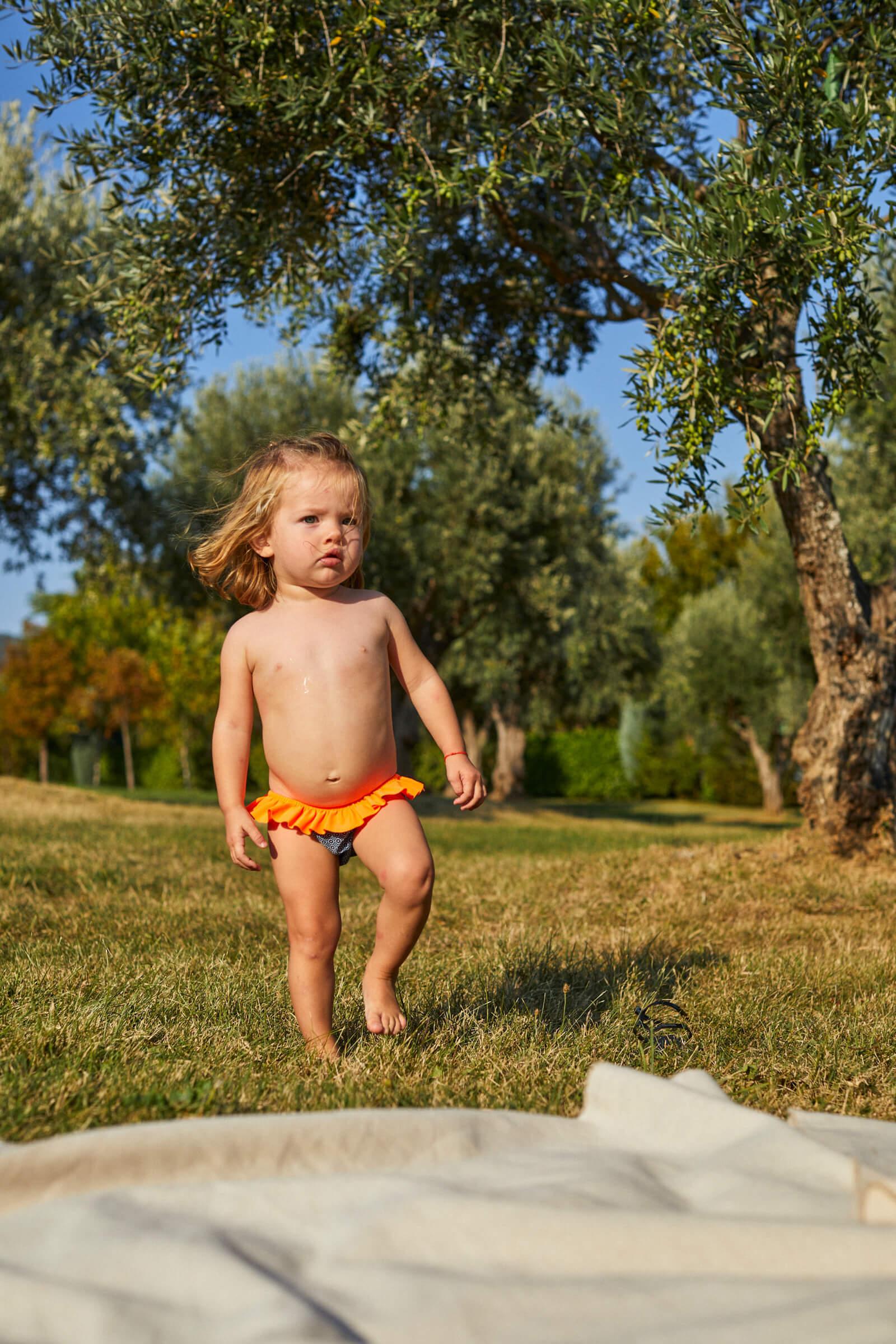baby girl wearing a Navy Pop Azulejos bikini bottom