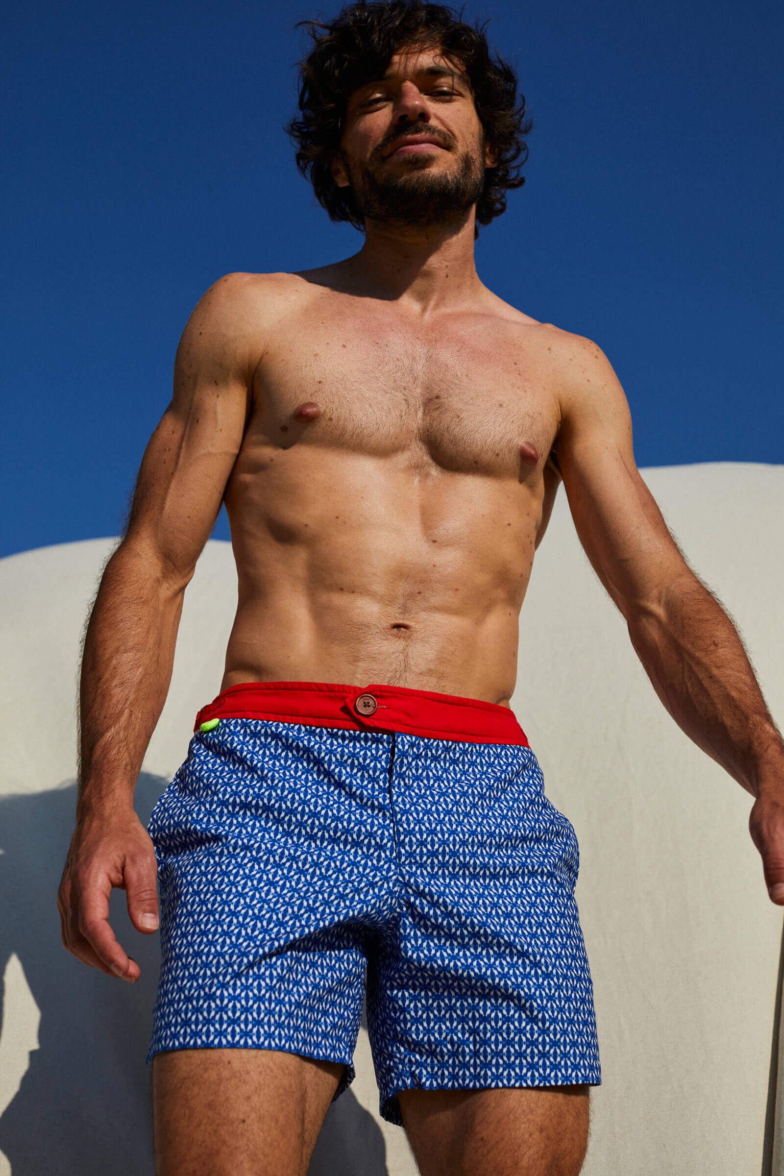 Man wearing a swimsuit with buttoned belt Air Navy Kangaroos