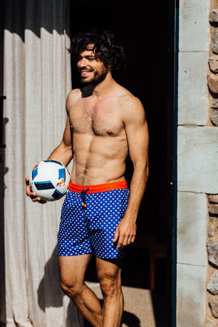Man wearing a Cocorico swimsuit with elasticated belt