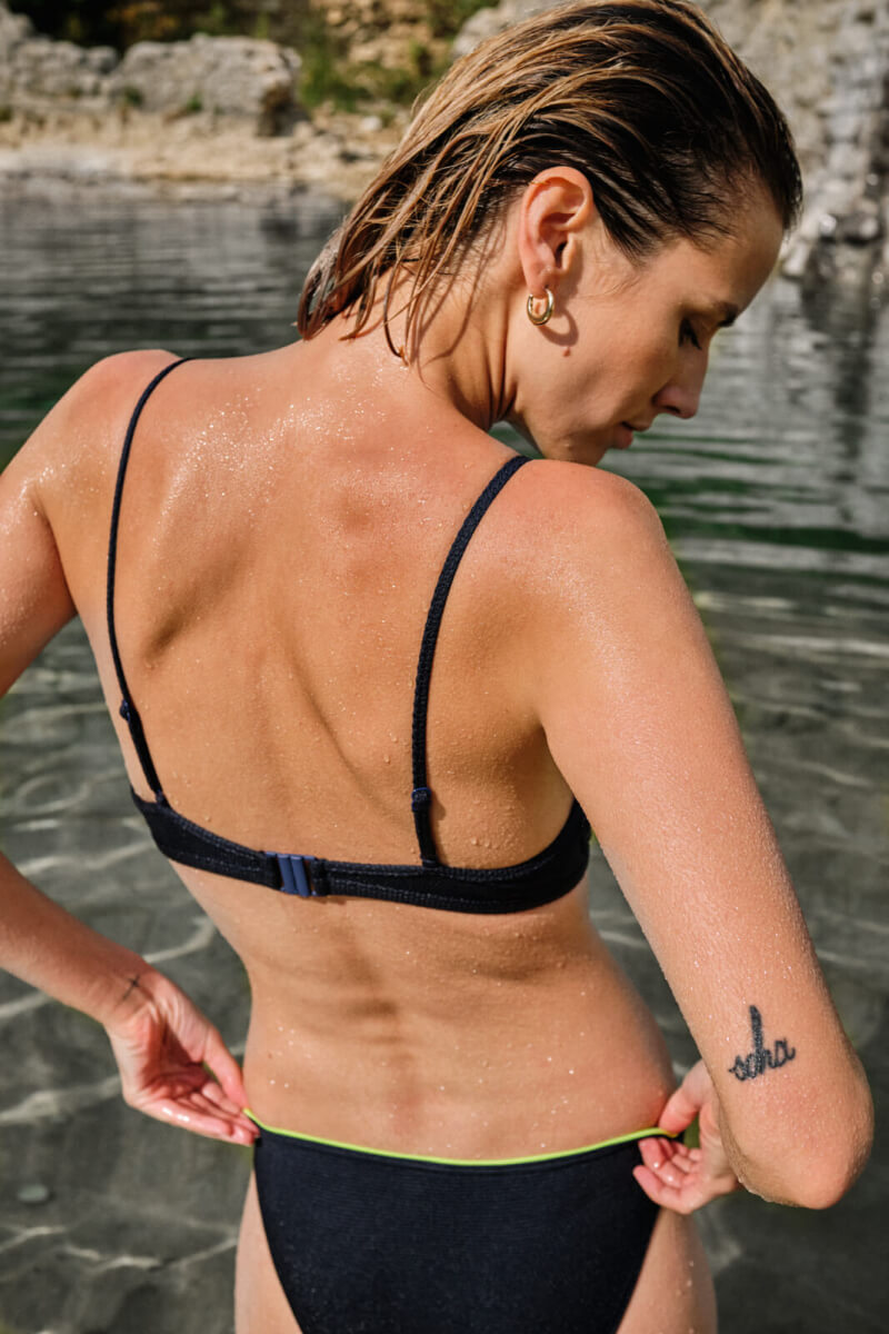 woman wearing a two-piece swimsuit intense blue