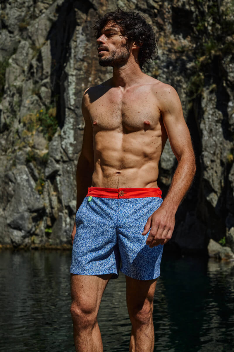 Man wearing a swimsuit with buttoned belt Off the Coast