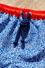 Garçon portant un maillot de bain à ceinture élastique Meno Off the Coast