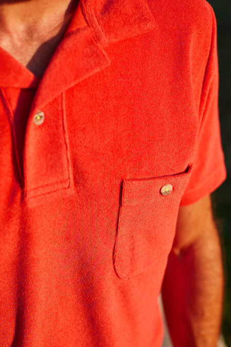 man wearing a terracotta terry cloth polo