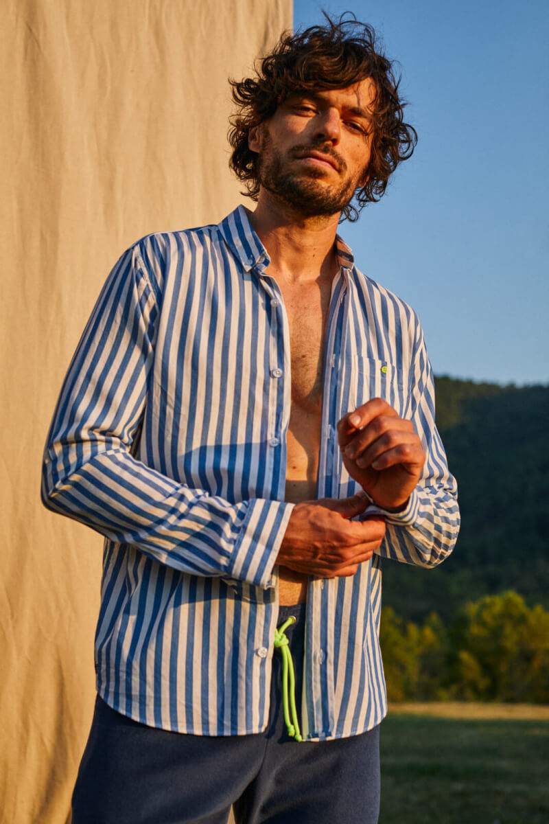 Man wears a Light shirt with large stripes