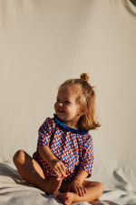 Little girl wearing a Lucy in the Sky anti UV t-shirt